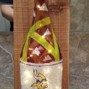 Wood Mounted Lighted Vikings bottle
